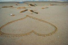 Η επιθυμία αγάπης στην παραλία και την παραλία στοκ εικόνες