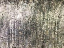 Η επιφάνεια των παλαιών γκρίζων συμπαγών τοίχων φαίνεται ισχυρή, ανθεκτικός στους παντός καιρού όρους Διακοσμήστε και μέσα και έξ στοκ φωτογραφία