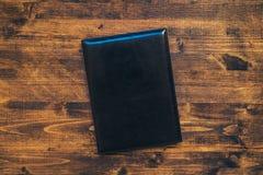 Η επιχειρησιακή ημερήσια διάταξη σημειωματάριων σχεδίου με το δέρμα καλύπτει τη τοπ άποψη Στοκ φωτογραφία με δικαίωμα ελεύθερης χρήσης