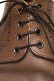 Η λεπτομέρεια επανδρώνει το παπούτσι Στοκ Εικόνες