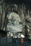 η εστίαση του Βούδα Κίνα grottoes το χειρωνακτικό άγαλμα στοκ εικόνες
