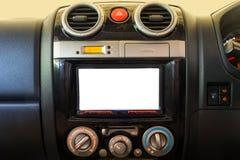 Η εσωτερική λεπτομέρεια του σύγχρονου ταμπλό αυτοκινήτων πολυτέλειας με το μεγάλο κουμπί επίδειξης και συναγερμών και το κλιματισ Στοκ Εικόνες
