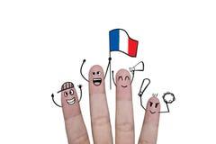 Η ευθυμία έννοιας δάχτυλων επάνω στο ποδόσφαιρο ομάδων με κρατά ψηλά τη σημαία Γαλλία Στοκ φωτογραφία με δικαίωμα ελεύθερης χρήσης
