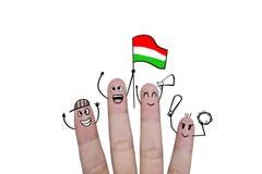 Η ευθυμία έννοιας δάχτυλων επάνω στο ποδόσφαιρο ομάδων με κρατά ψηλά τη σημαία Ουγγαρία Στοκ φωτογραφία με δικαίωμα ελεύθερης χρήσης