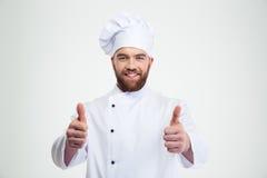 Η ευτυχής αρσενική παρουσίαση μαγείρων αρχιμαγείρων φυλλομετρεί επάνω Στοκ φωτογραφία με δικαίωμα ελεύθερης χρήσης