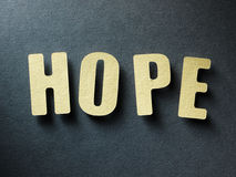 Η ελπίδα λέξης στο υπόβαθρο εγγράφου Στοκ φωτογραφία με δικαίωμα ελεύθερης χρήσης