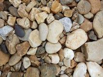 Η ζωηρόχρωμη σύσταση χαλικιών, αμμοχάλικο ψεκάζεται στο πάτωμα στοκ εικόνα με δικαίωμα ελεύθερης χρήσης
