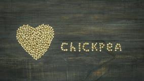 """Η ζωτικότητα κινήσεων στάσεων """"chickpea """"της εμφάνισης επιγραφής και η καρδιά λογαριάζουν το σχηματισμό από chickpeas, ζωτικότητα φιλμ μικρού μήκους"""