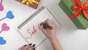Η ημέρα βαλεντίνων ` s, απεικόνιση, χέρι γυναικών ` s γράφει σε ένα σημειωματάριο, πώληση 10 τοις εκατό από 60 fps φιλμ μικρού μήκους