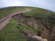 Η διάβρωση είναι να συμβεί γρήγορα μεγάλα χοντρά κομμάτια του εδάφους που χάνονται στη θάλασσα Στοκ Εικόνες