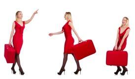 Η διακινούμενη γυναίκα με τη βαλίτσα που απομονώνεται στο λευκό Στοκ Εικόνες