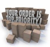 Η διαταγή σας είναι αποθήκη εμπορευμάτων σημαντικό de κιβωτίων συσκευασιών ύψιστης προτεραιότητας Στοκ εικόνες με δικαίωμα ελεύθερης χρήσης