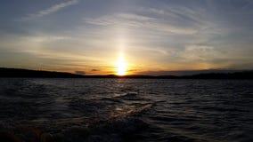 Ηλιοβασίλεμα από το νερό Στοκ Εικόνες