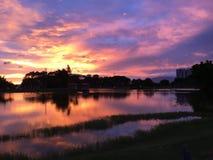 Ηλιοβασίλεμα και αντανάκλαση νερού Στοκ Εικόνες