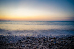 Ηλιοβασίλεμα και κύματα Στοκ Εικόνα