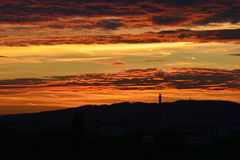 Ηλιοβασίλεμα και σκιαγραφία Στοκ Εικόνες