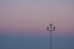 Ηλιοβασίλεμα με ένα lamppost Στοκ Φωτογραφίες