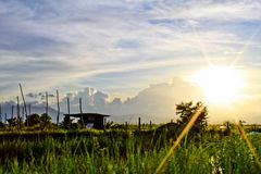 Ηλιοβασίλεμα με τα clounds Στοκ Εικόνες