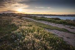 Ηλιοβασίλεμα πέρα από τον κόλπο του ST Thomas Στοκ Εικόνες