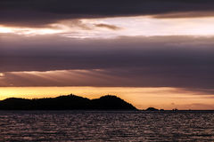 Ηλιοβασίλεμα πέρα από SanYa στοκ εικόνες