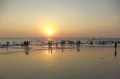 Ηλιοβασίλεμα, παραλία Calangute, Goa, Ινδία Στοκ Φωτογραφίες