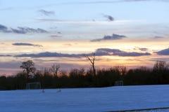 Ηλιοβασίλεμα ποδοσφαίρου Στοκ Φωτογραφίες