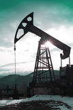 Ηλιοβασίλεμα πλατφορμών άντλησης πετρελαίου Στοκ Φωτογραφίες