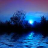 Ηλιοβασίλεμα στον ποταμό στοκ εικόνα