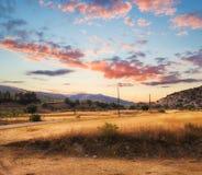 Ηλιοβασίλεμα στους τομείς φθινοπώρου της Κύπρου Στοκ Φωτογραφίες
