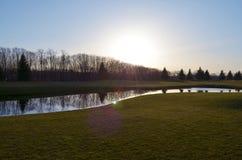 Ηλιοβασίλεμα στο γήπεδο του γκολφ Στοκ Φωτογραφίες