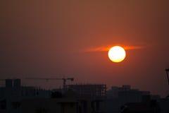 Ηλιοβασίλεμα στο εργοτάξιο οικοδομής Στοκ Εικόνες