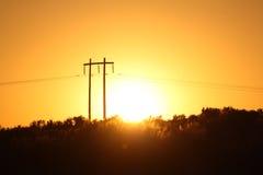 Ηλιοβασίλεμα τηλεφωνικού Πολωνού Στοκ Φωτογραφία