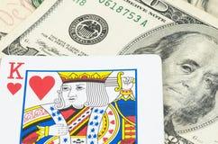 Η κάρτα βασιλιάδων στο αμερικανικό δολάριο, χρήματα είναι βασιλιάς Στοκ Φωτογραφία