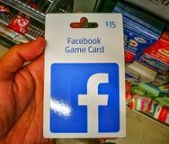 Η κάρτα παιχνιδιών Facebook είναι η γρήγορη και ο εύκολος τρόπος να αγοραστούν τα στοιχεία στα αγαπημένα παιχνίδια σας και apps σ Στοκ Φωτογραφία