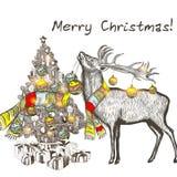 Η κάρτα Χριστουγέννων με το μπιχλιμπίδι εκμετάλλευσης ελαφιών και διακοσμεί τα Χριστούγεννα τ Στοκ εικόνες με δικαίωμα ελεύθερης χρήσης