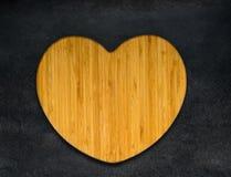 Η καρδιά διαμόρφωσε τον ξύλινο πίνακα Στοκ Εικόνα