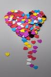 Η καρδιά που γίνεται με τις μικρές καρδιές Στοκ Εικόνες