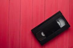 Η κασέτα για το όργανο καταγραφής ταινιών σε έναν ξύλινο πίνακα Στοκ εικόνα με δικαίωμα ελεύθερης χρήσης