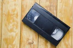 Η κασέτα για το όργανο καταγραφής ταινιών σε έναν ξύλινο πίνακα Στοκ Φωτογραφίες