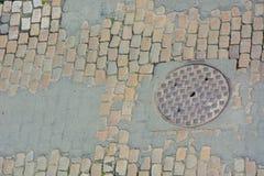 Η καταπακτή στο α η παλαιά οδός Στοκ Φωτογραφία