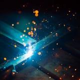 Η καλλιτεχνική συγκόλληση προκαλεί το ελαφρύ, βιομηχανικό υπόβαθρο Στοκ Εικόνα