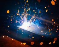 Η καλλιτεχνική συγκόλληση προκαλεί το ελαφρύ, βιομηχανικό υπόβαθρο Στοκ Φωτογραφίες