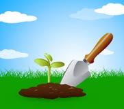 Η κηπουρική Trowel αντιπροσωπεύει τη μικρές σπορά και τη δενδροκηποκομία Στοκ φωτογραφία με δικαίωμα ελεύθερης χρήσης
