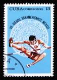 Η Κούβα παρουσιάζει άλτη, που αφιερώνεται στη 7η αμερικανική νεολαία τα παιχνίδια στο Μεξικό, circa το 1975 Στοκ εικόνα με δικαίωμα ελεύθερης χρήσης