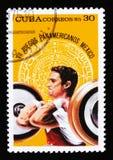 Η Κούβα παρουσιάζει ανύψωση βάρους, που αφιερώνεται στη 7η αμερικανική νεολαία τα παιχνίδια στο Μεξικό, circa το 1975 Στοκ Εικόνες