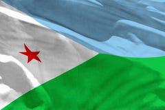 Η κυματίζοντας σημαία του Τζιμπουτί για τη χρησιμοποίηση ως σύσταση ή υπόβαθρο, η σημαία κυματίζει στον αέρα στοκ εικόνες