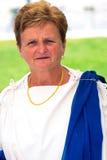 Η κυρία έντυσε στη ρωμαϊκή τήβεννο Στοκ Φωτογραφία
