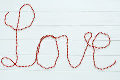 Η κόκκινη αγάπη λέξης Στοκ φωτογραφία με δικαίωμα ελεύθερης χρήσης