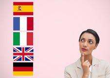 η κύρια γλώσσα σημαιοστολίζει κοντά στη νέα επιχειρηματία Ρόδινη ανασκόπηση Στοκ Εικόνα