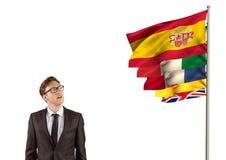η κύρια γλώσσα σημαιοστολίζει κοντά στον επιχειρηματία Στοκ εικόνα με δικαίωμα ελεύθερης χρήσης